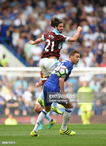 Chelsea's Cesar Azpilicueta and Burnley's George Boyd compete for a header