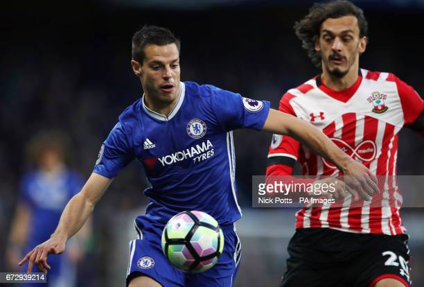 Chelsea's Cesar Azpilicueta and Southampton's Manolo Gabbiadini battle for the ball during the Premier League match at Stamford Bridge London