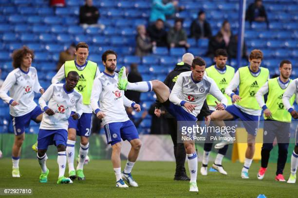 Chelsea's Cesar Azpilicueta and teammates warm up before the Premier League match at Stamford Bridge London