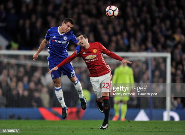 Chelsea's Cesar Azpilicueta battles for possession with Manchester United's Henrikh Mkhitaryan during the Emirates FA Cup QuarterFinal match between...