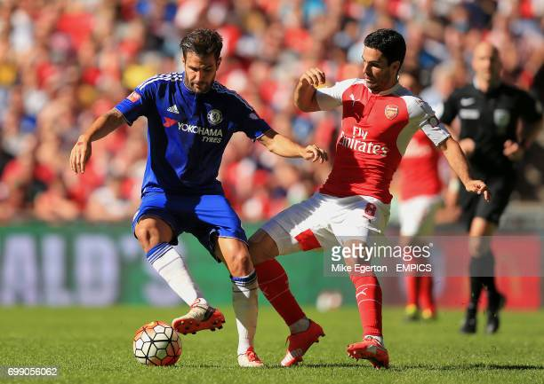 Chelsea's Cesc Fabregas and Arsenal's Mikel Arteta battle for the ball