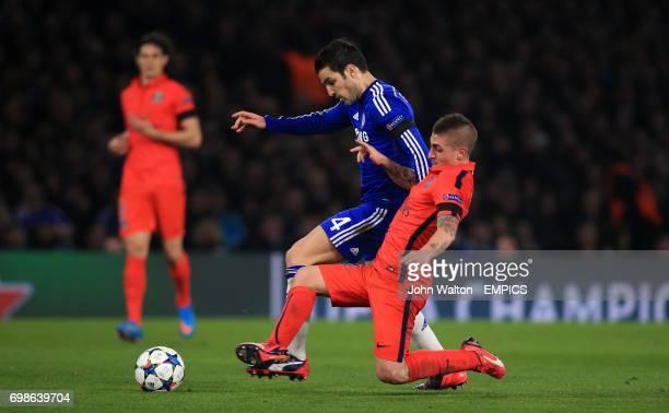 Chelsea's Cesc Fabregas and Paris St Germain's Marco Verratti battle for the ball