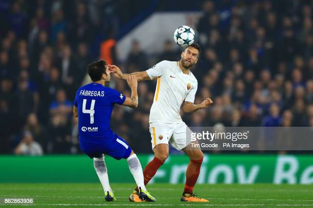 Chelsea's Cesc Fabregas and Roma's Kevin Strootman battle for the ball during the UEFA Champions League Group C match at Stamford Bridge London