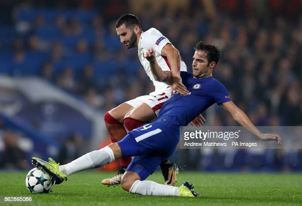 Chelsea's Cesc Fabregas and Roma's Maxime Gonalons battle for the ball during the UEFA Champions League Group C match at Stamford Bridge London
