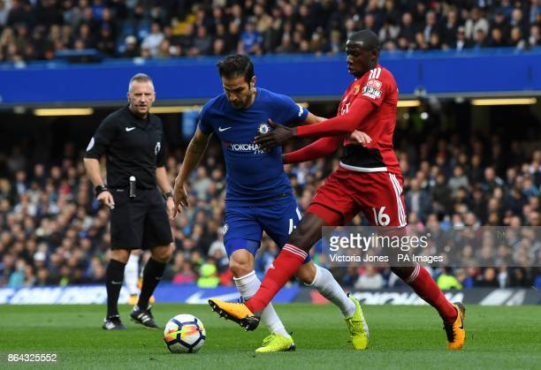 Chelsea's Cesc Fabregas and Watford's Abdoulaye Doucoure battle for the ball during the Premier League match at Stamford Bridge London