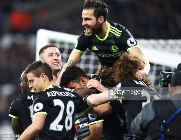 Chelsea's Cesc Fabregas celebrates Chelsea's Diego Costagoal during the prematch warmup during EPL Premier League match between West Ham United...