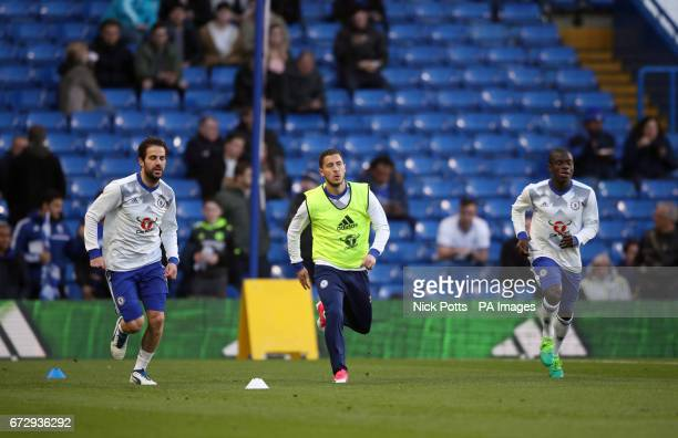 Chelsea's Cesc Fabregas Eden Hazard and N'Golo Kante warm up before the Premier League match at Stamford Bridge London