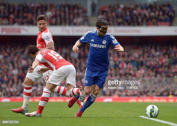 Chelsea's Cesc Fabregas goes down in the penalty area under the challenge of Arsenal's Santi Cazorla
