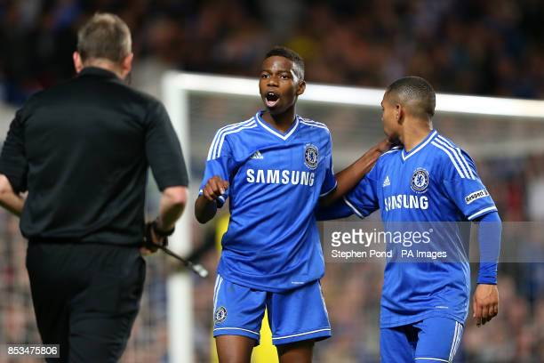 Chelsea's Charly Musonda and Jake ClarkeSalter speak with referee Jonathan Moss