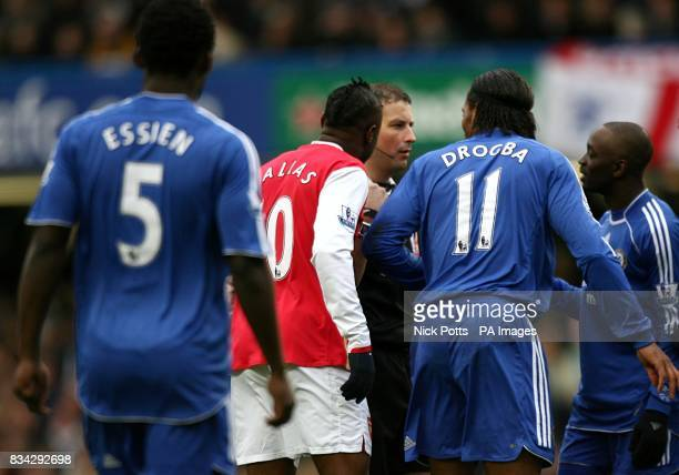 Chelsea's Claude Makelele and Didier Drogba and Arsenal's William Gallas crowd round referee Mark Clattenburg