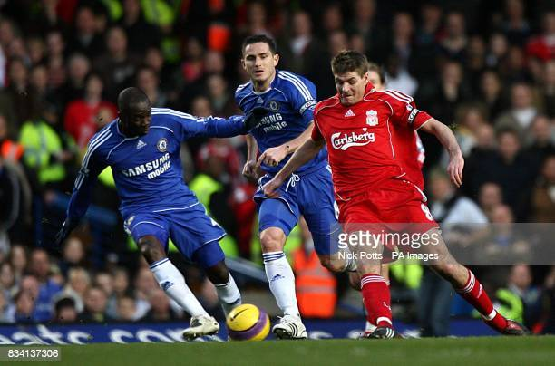 Chelsea's Claude Makelele and Liverpool's Steven Gerrard battle for the ball as Chelsea's Frank Lampard looks on