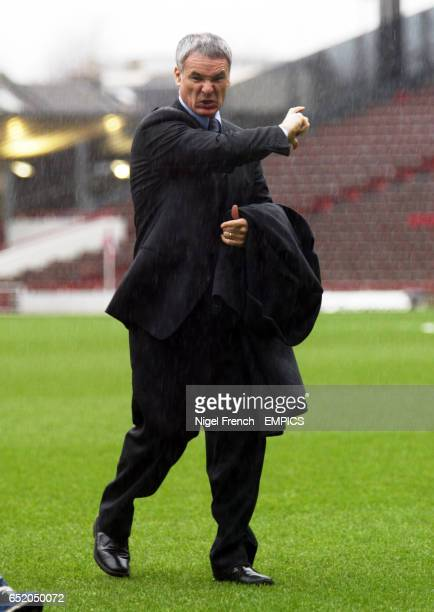 Chelsea's Claudio Ranieri walks off the sodden Highbury pitch