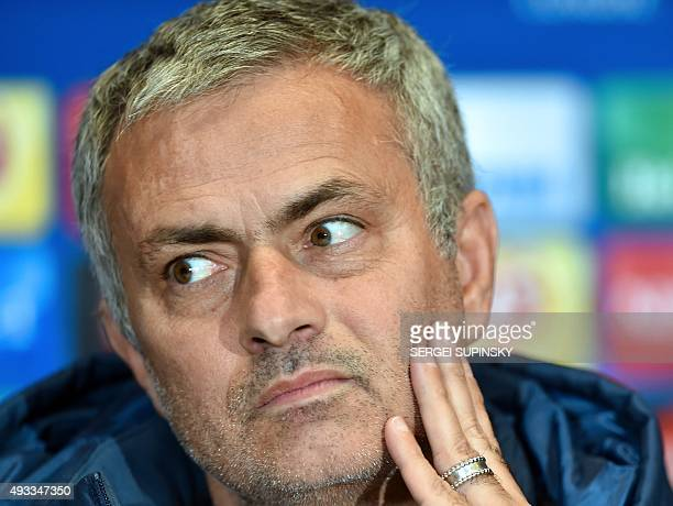 Chelsea's coach Jose Mourinho looks on during a press conference at Olimpisky Stadium in Kiev on October 19 on the eve of the UEFA Champions League...