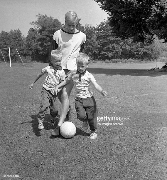 Chelsea's Colin Maldron gets in some tackling practice with two brothers Mark and Stephen Burton from Carshalton