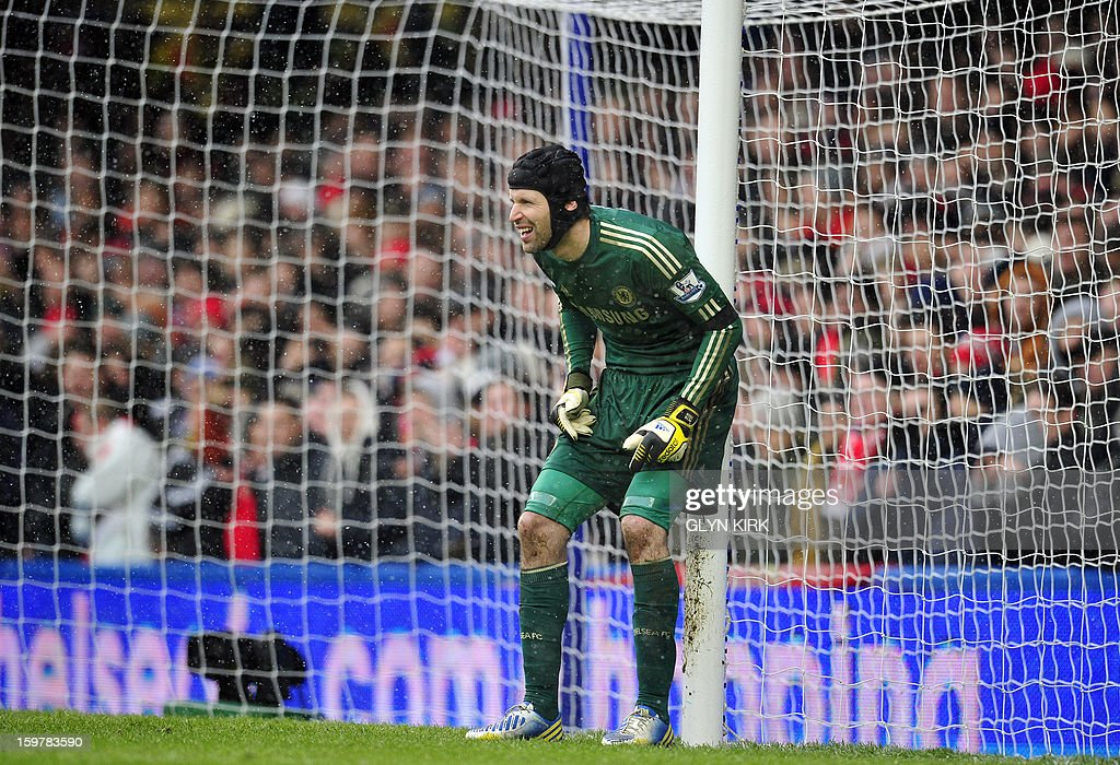 "Chelsea's Czech goalkeeper Petr Cech lines up his defence for a free kick during their English Premier League football match against Arsenal at Stamford Bridge in London, England on January 20, 2013. USE. No use with unauthorized audio, video, data, fixture lists, club/league logos or ""live"" services. Online in-match use limited to 45 images, no video emulation. No use in betting, games or single club/league/player publications."