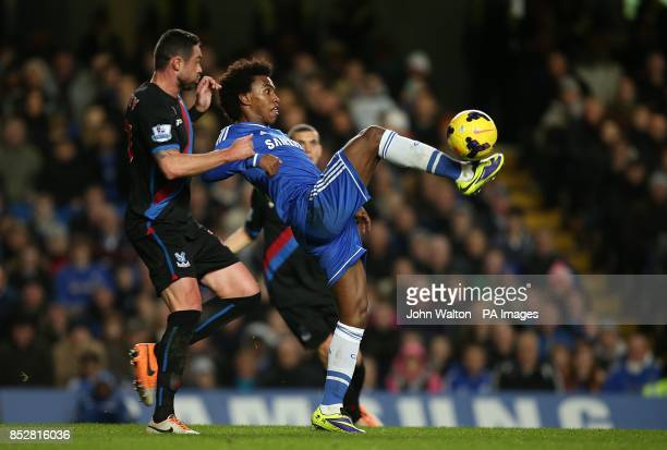 Chelsea's da Silva Willian and Crystal Palace's Damien Delaney battle for the ball