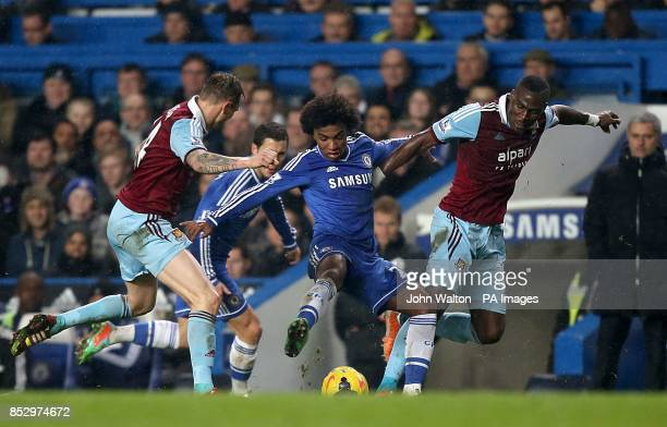 Chelsea's da Silva Willian in action with West Ham United's Guy Demel and Matthew Taylor