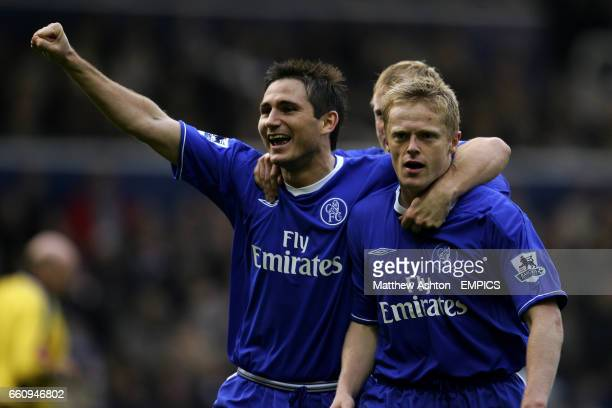 Chelsea's Damien Duff celebrates scoring the third goal with teammate Frank Lampard