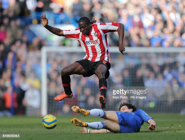 Chelsea's David Luiz and Brentford's Clayton Donaldson battle for the ball