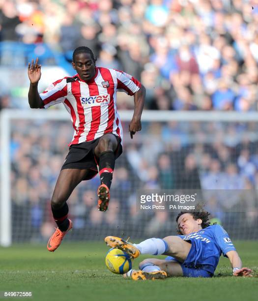 Chelsea's David Luiz and Brentford's's Clayton Donaldson in action