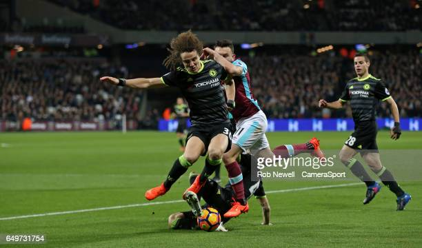 Chelsea's David Luiz and West Ham United's Robert Snodgrass during the Premier League match between West Ham United and Chelsea at London Stadium on...