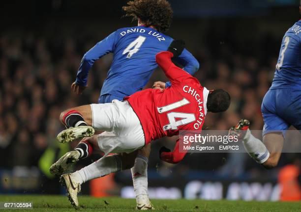 Chelsea's David Luiz elbows Manchester United's Javier Hernandez off the ball