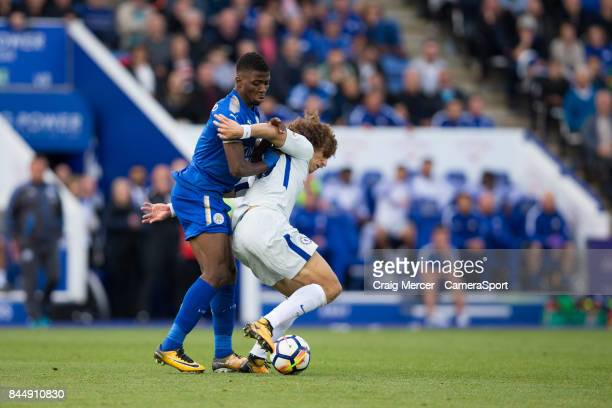 Chelsea's David Luiz is fouled by Leicester City's Kelechi Iheanacho during the Premier League match between Leicester City and Chelsea at The King...