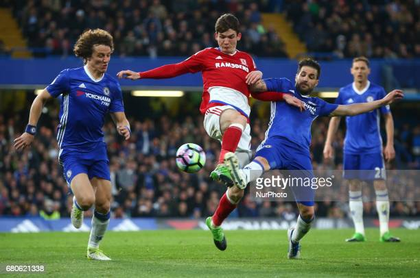 LR Chelsea's David Luiz Marten de Roon of Middlesbrough and Chelsea's Cesc Fabregas during Premier League match between Chelsea and Middlesbrough at...
