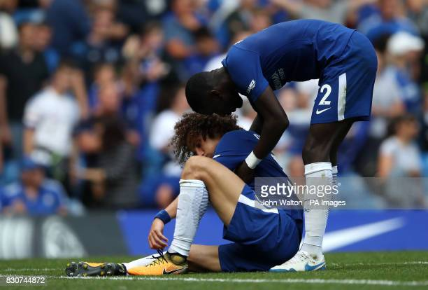 Chelsea's David Luiz shows his dejection after the final whistle as he is helped up by Chelsea's Antonio Rudiger during the Premier League match at...