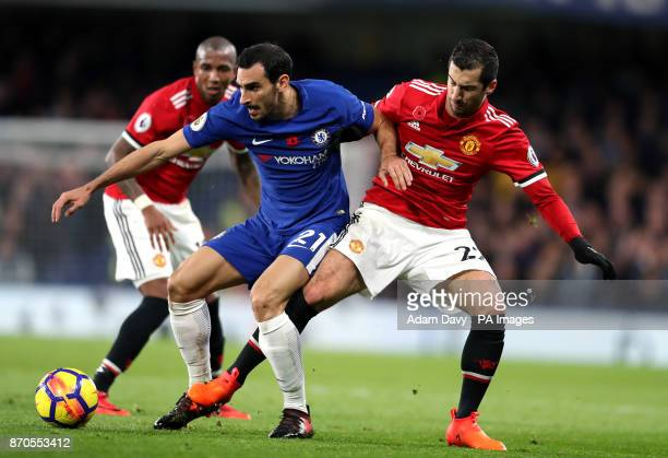 Chelsea's Davide Zappacosta and Manchester United's Henrikh Mkhitaryan battle for the ball during the Premier League match at Stamford Bridge London