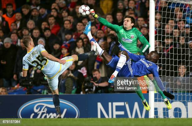 Chelsea's Demba Ba has a shot stopped by Steaua Bucurest goalkeeper Ciprian Tatarusanu with his teammate Pantelis Kapetanos