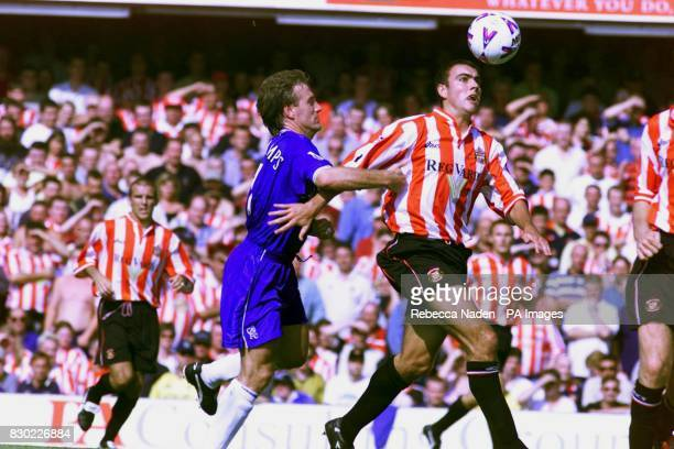 Chelsea's Didier Deschamps and Sunderland's Chris Makin in action during the FA Premiership clash at Stamford Bridge