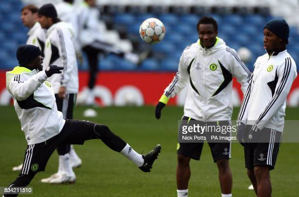 Chelsea's Didier Drogba and John Mikel Obi watch Claude Makelele juggle with the ball during a training session at Stamford Bridge London