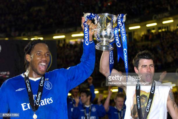 Chelsea's Didier Drogba and Mateja Kezman celebrate with the trophy