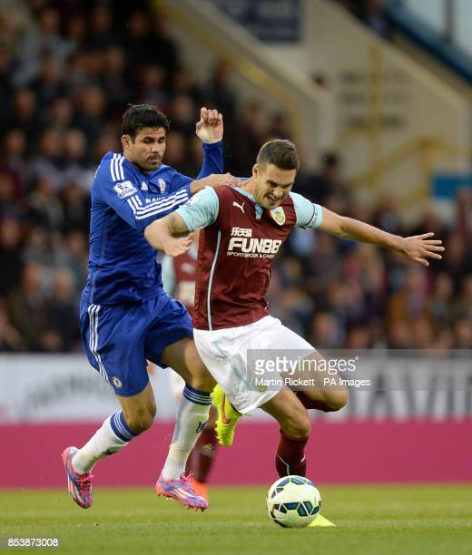 Chelsea's Diego Costa and Burnley's Jason Shackell battle for the ball during the Barclays Premier League match at Turf Moor Burnley