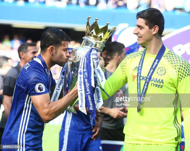 LR Chelsea's Diego Costa and Chelsea's Thibaut Courtois with Trophy during the Premier League match between Chelsea and Sunderland at Stamford Bridge...