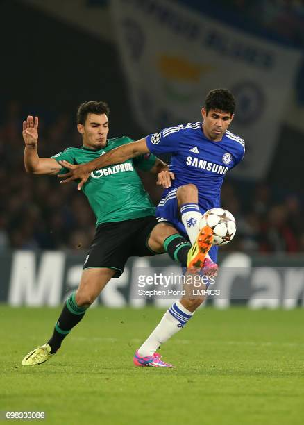 Chelsea's Diego Costa and FC Schalke's Kaan Ayhan compete for the ball