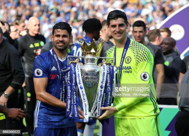 Chelsea's Diego Costa and goalkeeper Thibaut Courtois with the trophy after the Premier League match at Stamford Bridge London