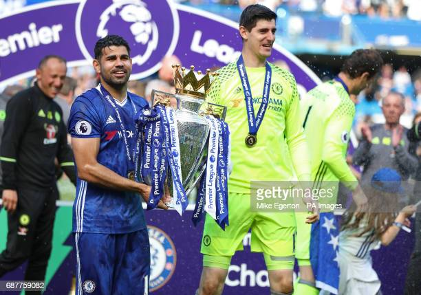 Chelsea's Diego Costa and Thibaut Courtois celebrate with the Premier League trophy after the game