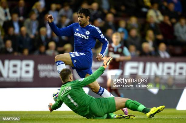 Chelsea's Diego Costa attempts to take the ball around Burnley goalkeeper Tom Heaton before being booked for diving during the Barclays Premier...