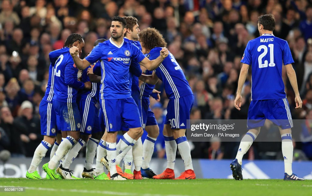 Chelsea's Diego Costa celebrates as N'Golo Kante is mobbed after scoring his sides opening goal during the Emirates FA Cup, Quarter Final match at Stamford Bridge, London.