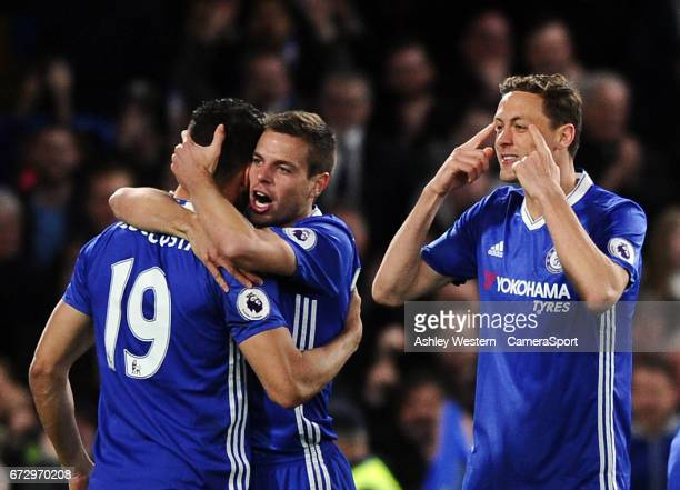 Chelsea's Diego Costa celebrates scoring his sides third goal with Cesar Azpilicueta and Nemanja Matic during the Premier League match between...