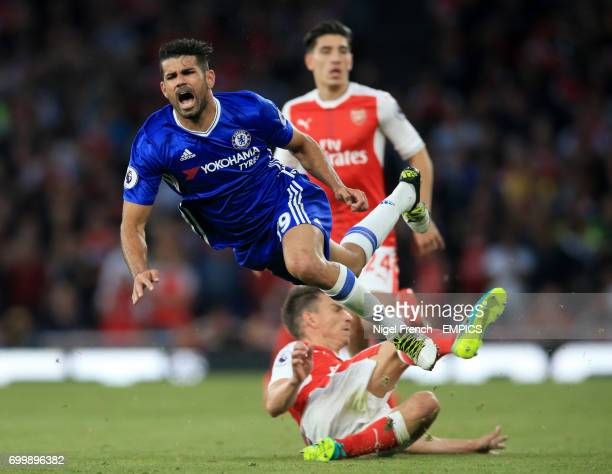 Chelsea's Diego Costa reacts to a challenge from Arsenal's Laurent Koscielny