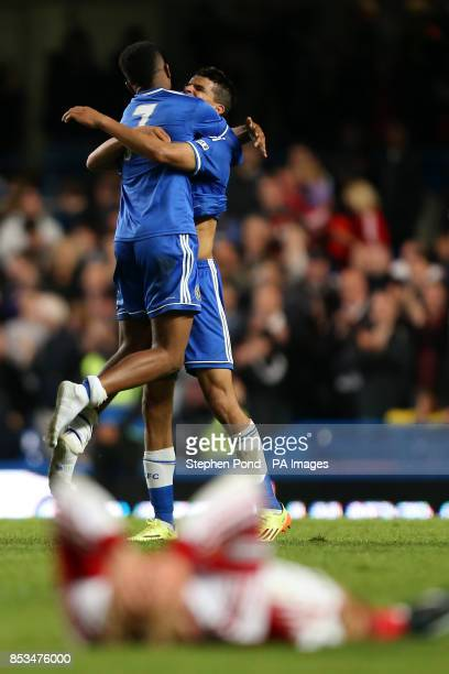 Chelsea's Dominic Solanke celebrates with teammates in front of a dejected Fulham player