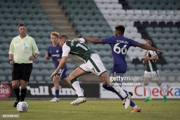 Chelsea's Dujon Sterling clips Plymouth Argyle's Aaron TaylorSinclair during the Checkatrade Trophy match at Home Park on August 15 2017 in Plymouth...