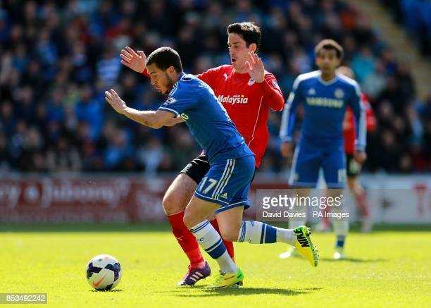 Chelsea's Eden Hazard and Cardiff City's Peter Whittingham battle for the ball
