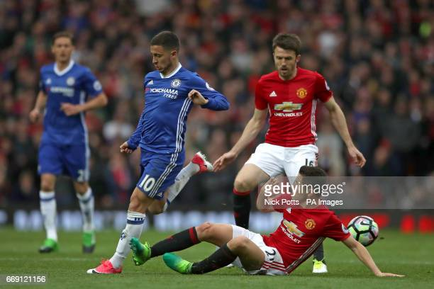 Chelsea's Eden Hazard and Manchester United's Ander Herrera battle for the ball during the Premier League match at Old Trafford Manchester