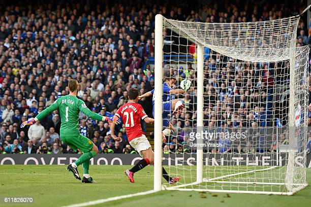 Chelsea's Eden Hazard attempts a shot past Manchester United's David De Gea and Ander Herrera but misses