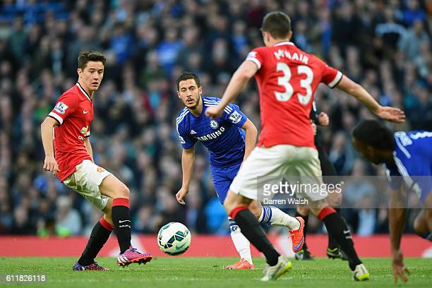 Chelsea's Eden Hazard between Manchester United's Ander Herrera and Manchester United's Paddy McNair