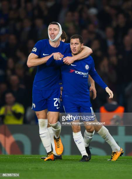 Chelsea's Eden Hazard celebrates scoring his side's third goal with Gary Cahill during the UEFA Champions League group C match between Chelsea FC and...